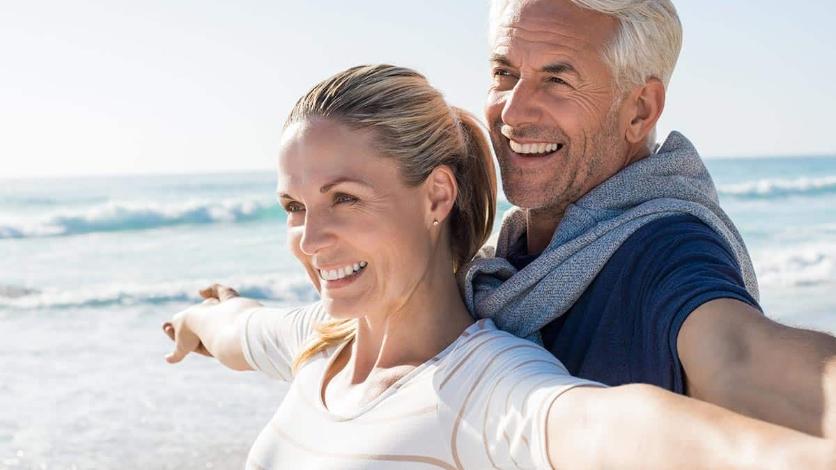 An Old Couple Posing for a Picture Around Beach